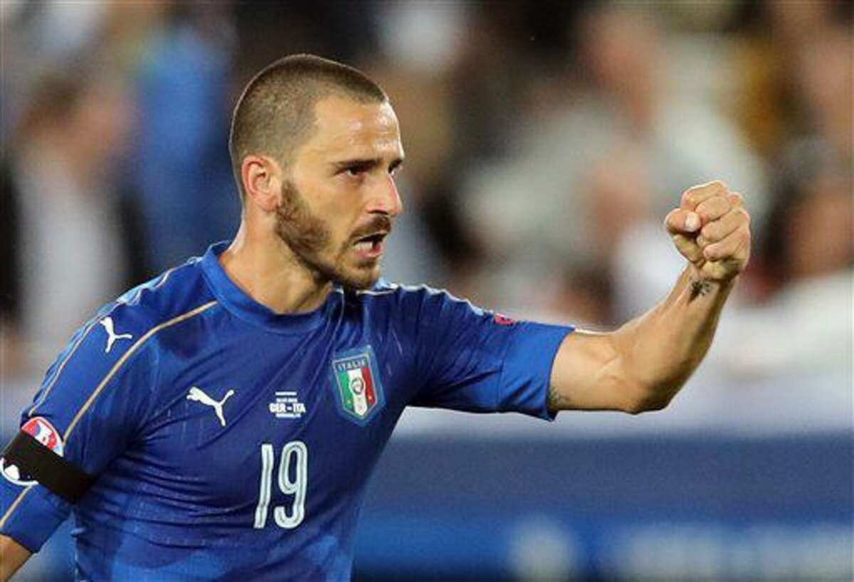 Italy's Leonardo Bonucci celebrates after scoring during the Euro 2016 quarterfinal soccer match between Germany and Italy, at the Nouveau Stade in Bordeaux, France, Saturday, July 2, 2016. (AP Photo/Thanassis Stavrakis)