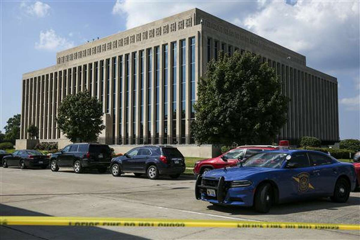 Police tape surrounds the Berrien County Courthouse on Monday, July 11, 2016 in St. Joseph, Mich. Two bailiffs were fatally shot Monday inside the courthouse before officers killed the gunman, a sheriff said. (Chelsea Purgahn/Kalamazoo Gazette via AP)