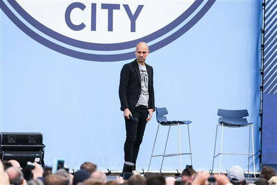 English soccer club Manchester City's new manager Pep Guardiola is unveiled to fans at the Etihad Stadium, Manchester, England, Sunday July 3, 2016. (Barrington Coombs/PA Wire via AP) Photo: Barrington Coombs