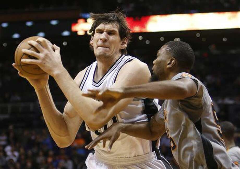 FILE - In this Jan. 21, 2016, file photo, San Antonio Spurs center Boban Marjanovic, left, works the ball inside during the third quarter of an NBA basketball game against the Phoenix Suns in Phoenix. The Detroit Pistons have signed Marjanovic to a $21 million, three-year contract, the team announced Tuesday, July 2, 2016. (AP Photo/Rick Scuteri, File) Photo: Rick Scuteri