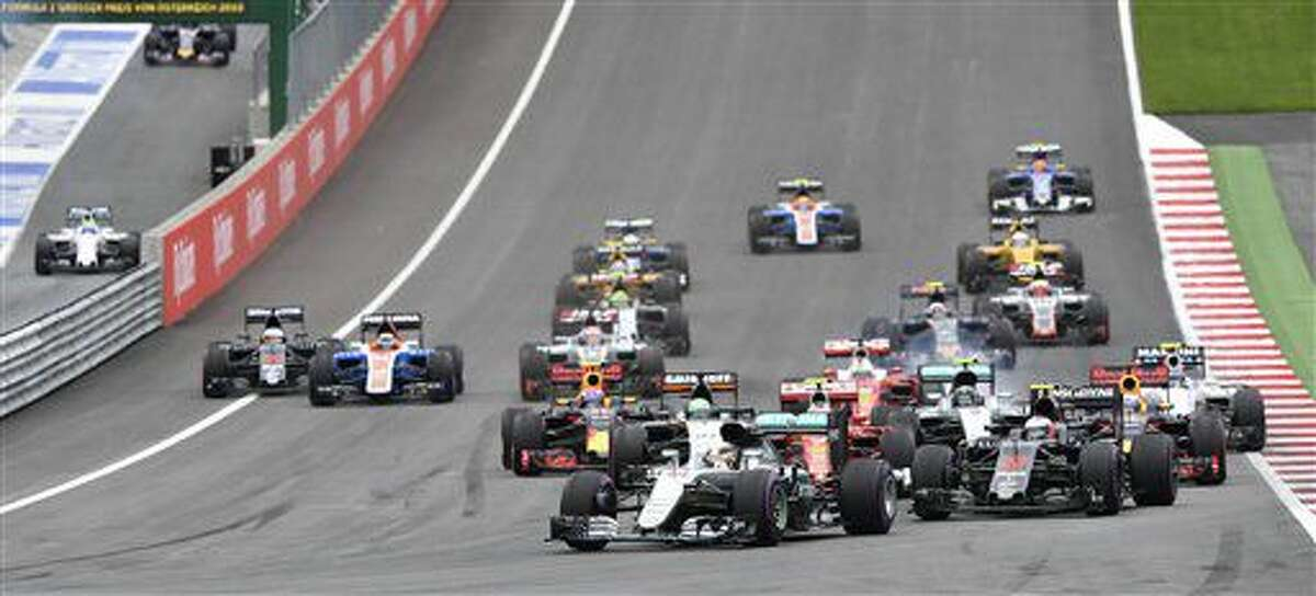 Mercedes driver Lewis Hamilton of Britain leads the field after the start during the Formula One Grand Prix, at the Red Bull Ring in racetrack, in Spielberg, Austria, Sunday, July. 3, 2016. (AP Photo/Kerstin Joensson)
