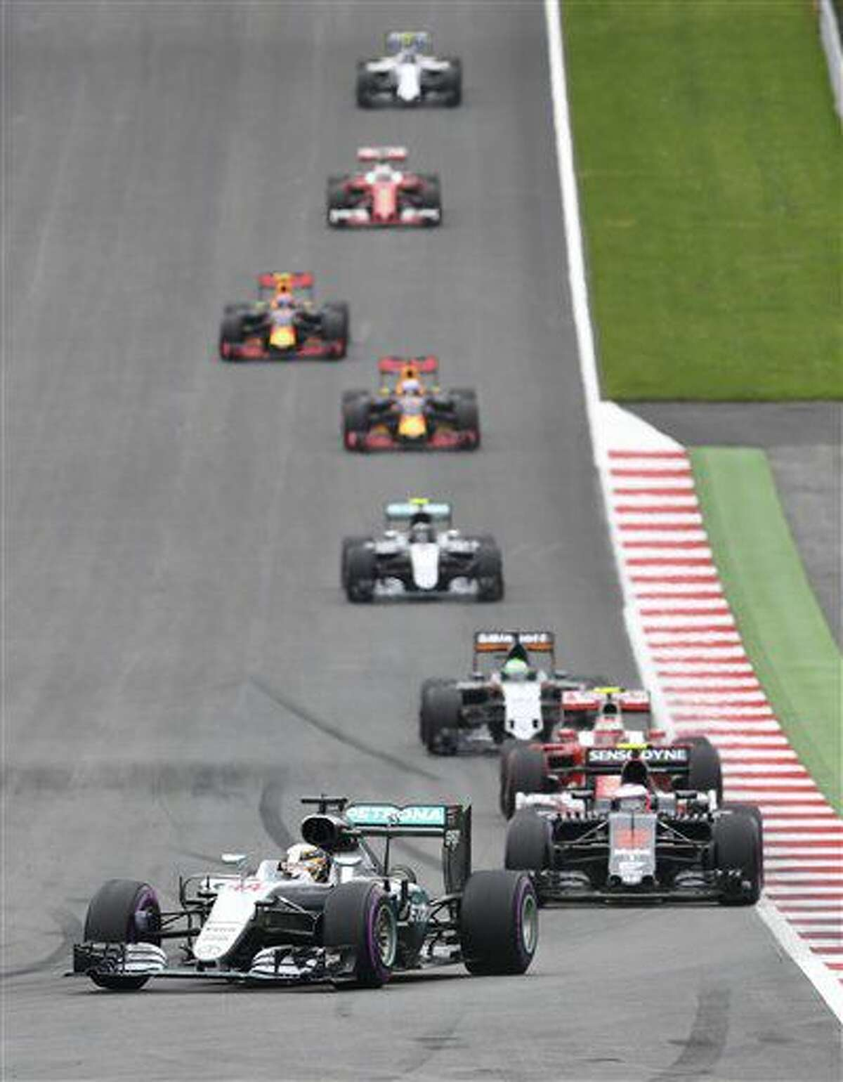 Mercedes driver Lewis Hamilton of Britain leads during the Formula One Grand Prix, at the Red Bull Ring in racetrack, in Spielberg, Austria, Sunday, July. 3, 2016. (AP Photo/Kerstin Joensson)