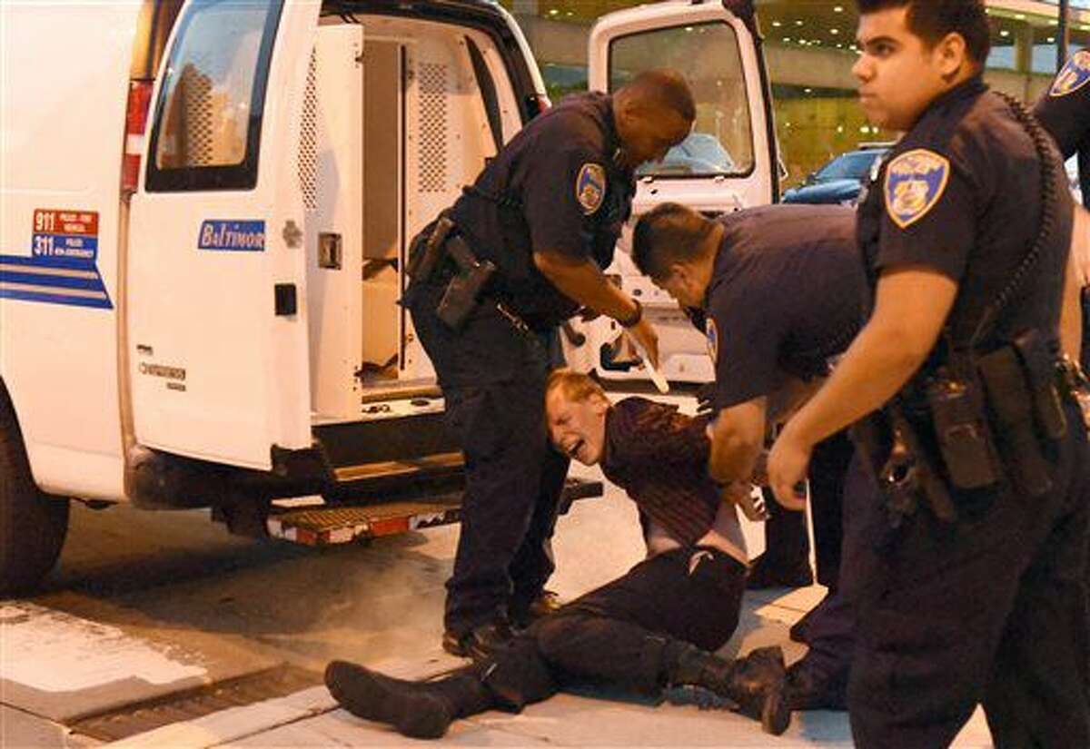 A protestor is arrested after he refused to keep moving down the street while protesting the fatal police shootings of Alton Sterling and Philando Castile, Friday, July 8, 2016, in Baltimore. (Jerry Jackson/The Baltimore Sun via AP)