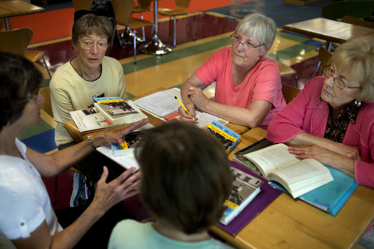 Book club members from bottom center: Becky Hodges, Mary Lawry, Ginny Jossi, Bobbie Baker and Helen Winslow talk about