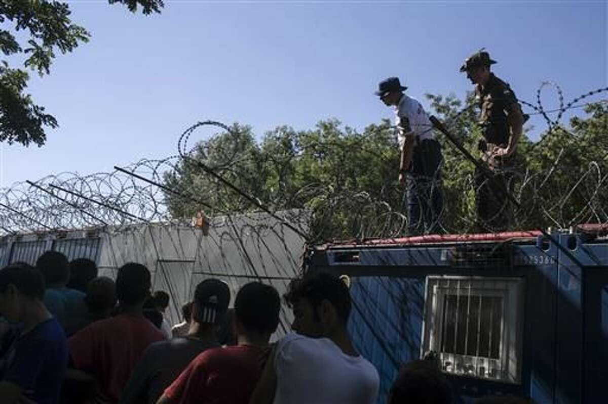 The Latest: Greece arrests 29 suspected of smuggling 600 in
