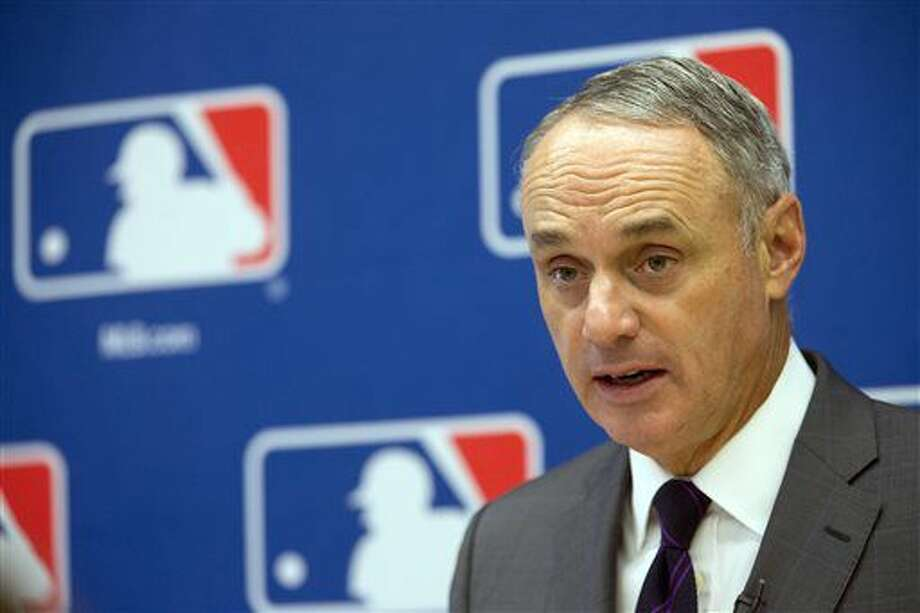 FILE - In this May 19, 2016, file photo, baseball Commissioner Rob Manfred speaks to reporters during a news conference at Major League Baseball headquarters in New York. With home runs up to a level not seen since the height of the Steroids Era, Manfred said Tuesday, July 12, 2016, he is not worried performance-enhancing drugs are a reason for the increase. (AP Photo/Mary Altaffer, File)