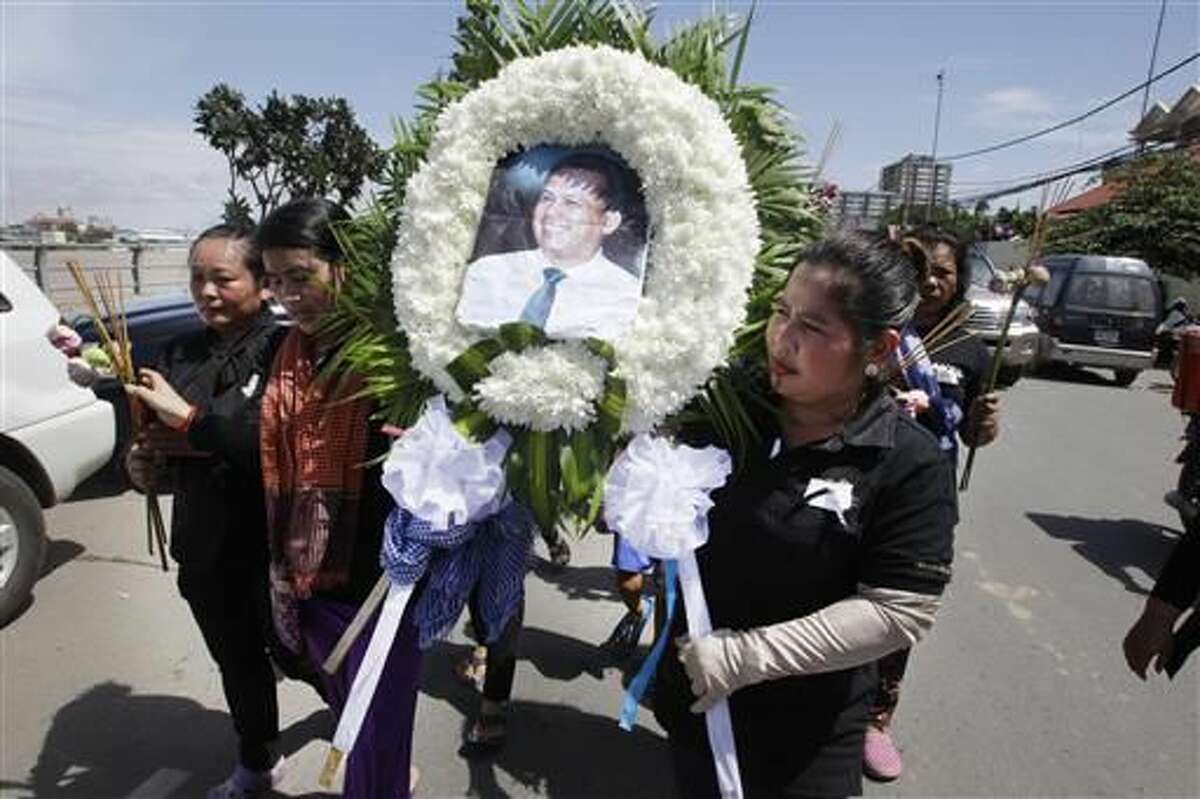 Cambodian charged with murder in government critic's killing