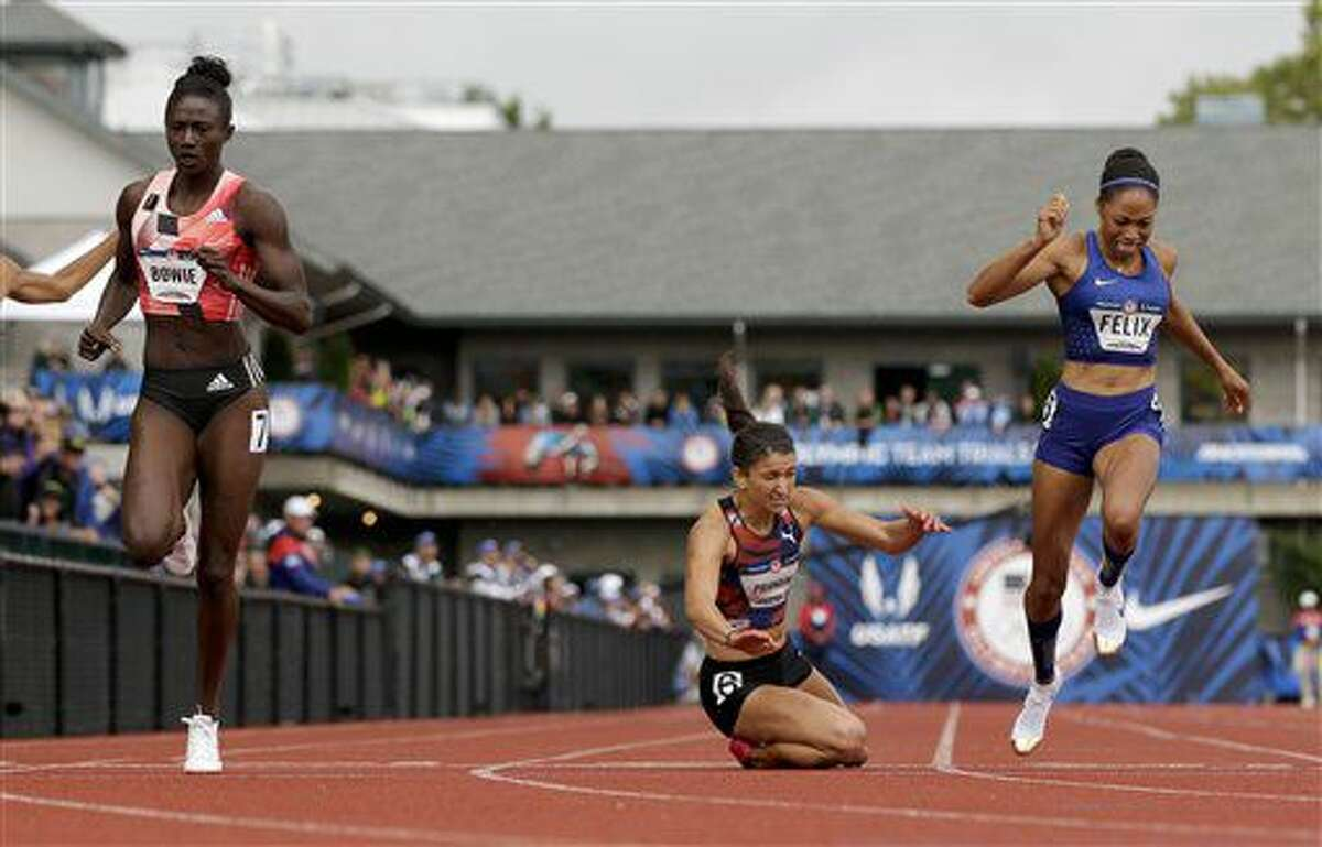 Tori Bowie, left, beats Jenna Prandini and Allyson Felix, right, in the finals of the women's 200-meter run at the U.S. Olympic Track and Field Trials, Sunday, July 10, 2016, in Eugene Ore. (AP Photo/Marcio Jose Sanchez)
