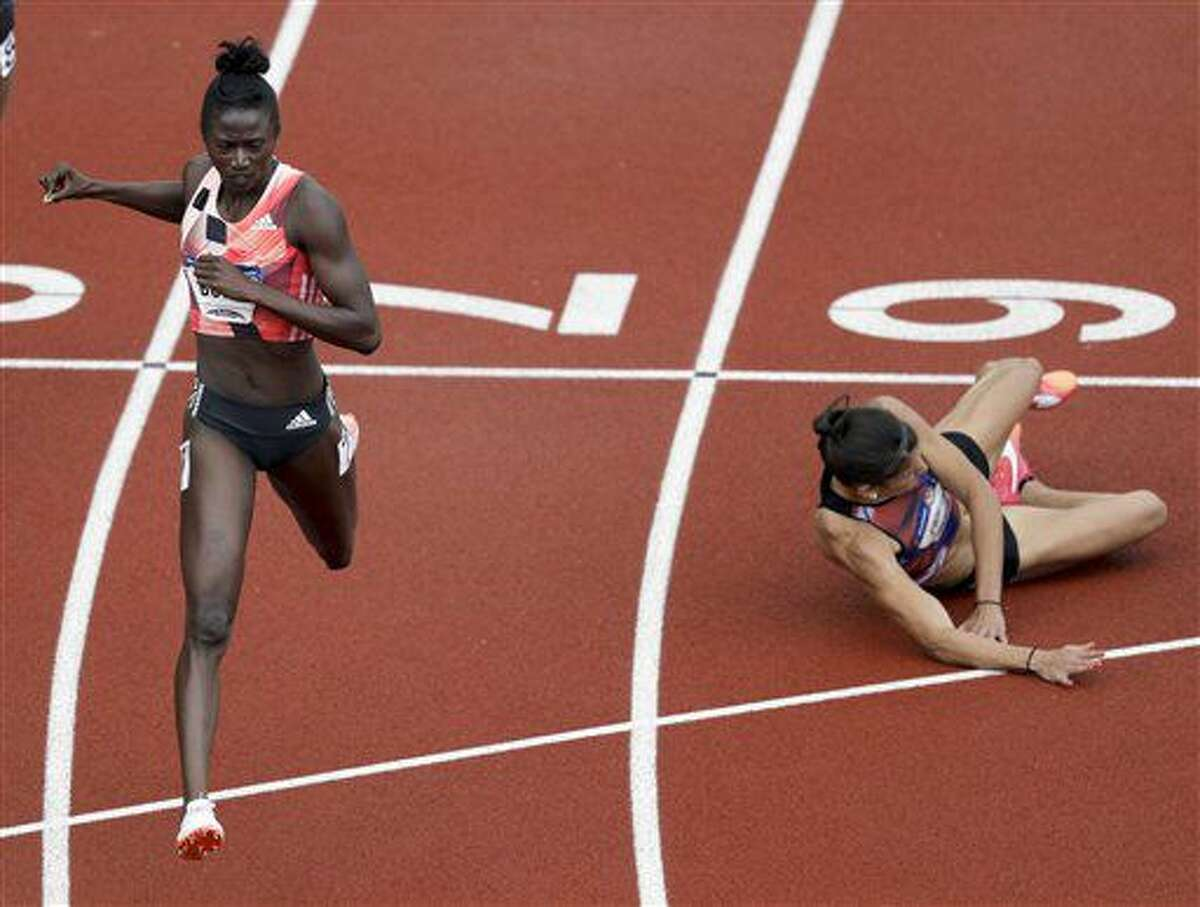 Tori Bowie, left, beats Jenna Prandini in the finals of the women's 200-meter run at the U.S. Olympic Track and Field Trials, Sunday, July 10, 2016, in Eugene Ore. (AP Photo/Charlie Riedel)
