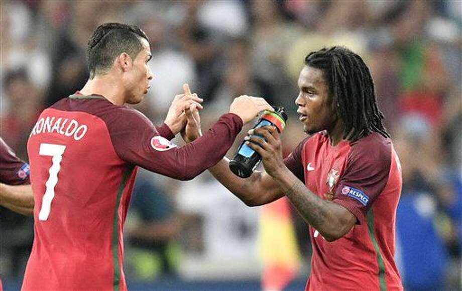 Portugal's Cristiano Ronaldo, left, congratulates Renato Sanches who scored their first goal during the Euro 2016 quarterfinal soccer match between Poland and Portugal, at the Velodrome stadium in Marseille, France, Thursday, June 30, 2016. (AP Photo/Martin Meissner) Photo: Martin Meissner