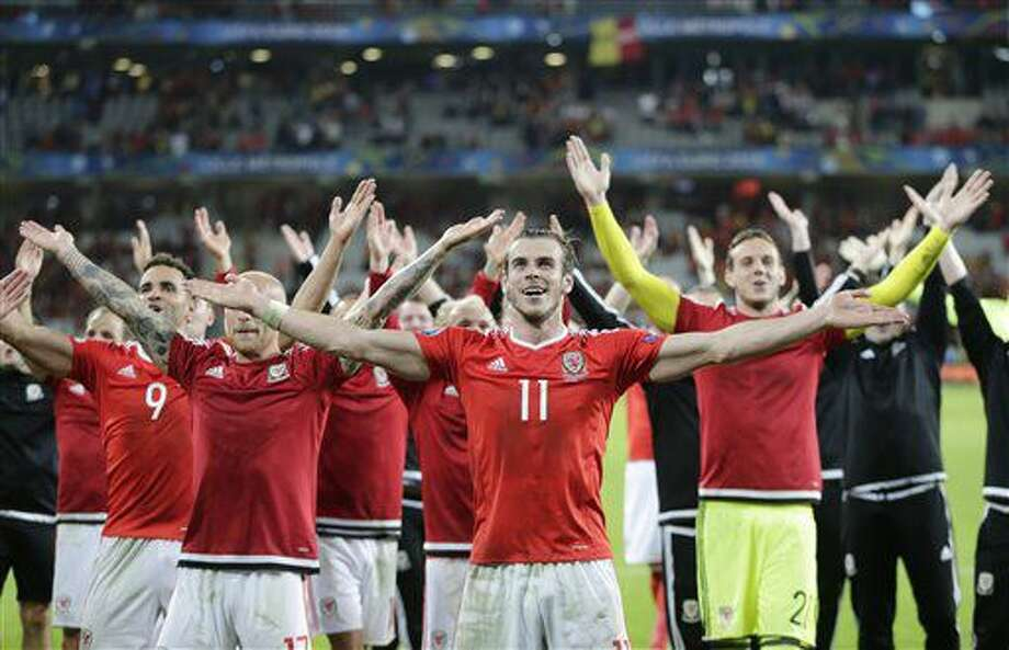 Wales' Gareth Bale, center, celebrates with his teammates after their 3-1 win at the end of the Euro 2016 quarterfinal soccer match between Wales and Belgium, at the Pierre Mauroy stadium in Villeneuve d'Ascq, near Lille, France, Friday, July 1, 2016. (AP Photo/Petr David Josek) Photo: Petr David Josek