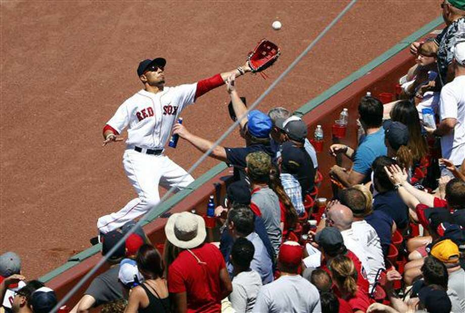 Boston Red Sox right fielder Mookie Betts cannot get to a foul fly ball in the right field corner by Los Angeles Angels' Jett Bandy during the third inning of a baseball game in Boston Sunday, July 3, 2016. (AP Photo/Winslow Townson) Photo: Winslow Townson