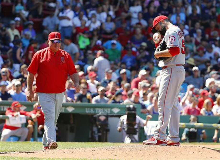 Los Angeles Angels manager Mike Scioscia walks to the mound to take starting pitcher Matt Shoemaker out of the game during the fifth inning of a baseball game against the Boston Red Sox at Fenway Park in Boston, Sunday, July 3, 2016. (AP Photo/Winslow Townson) Photo: Winslow Townson