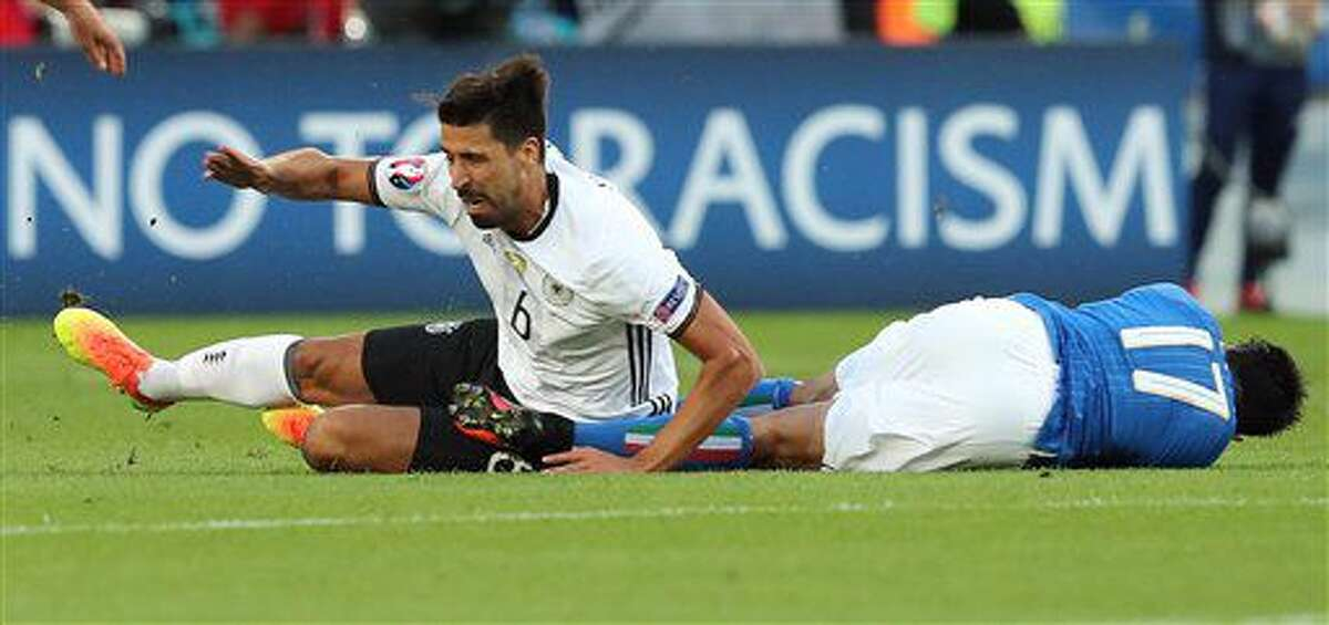 Germany's Sami Khedira, left, and Italy's Eder lie on the pitch during the Euro 2016 quarterfinal soccer match between Germany and Italy, at the Nouveau Stade in Bordeaux, France, Saturday, July 2, 2016. (AP Photo/Thanassis Stavrakis)