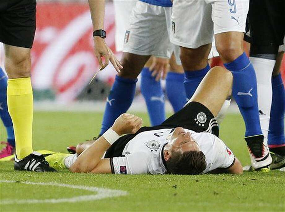 FILE--- Germany's Mario Gomez lies injured on the pitch during the Euro 2016 quarterfinal soccer match between Germany and Italy, at the Nouveau Stade in Bordeaux, France, Saturday, July 2, 2016. Gomez is injured and ruled out for the rest of the tournament. (AP Photo/Michael Probst) Photo: Michael Probst