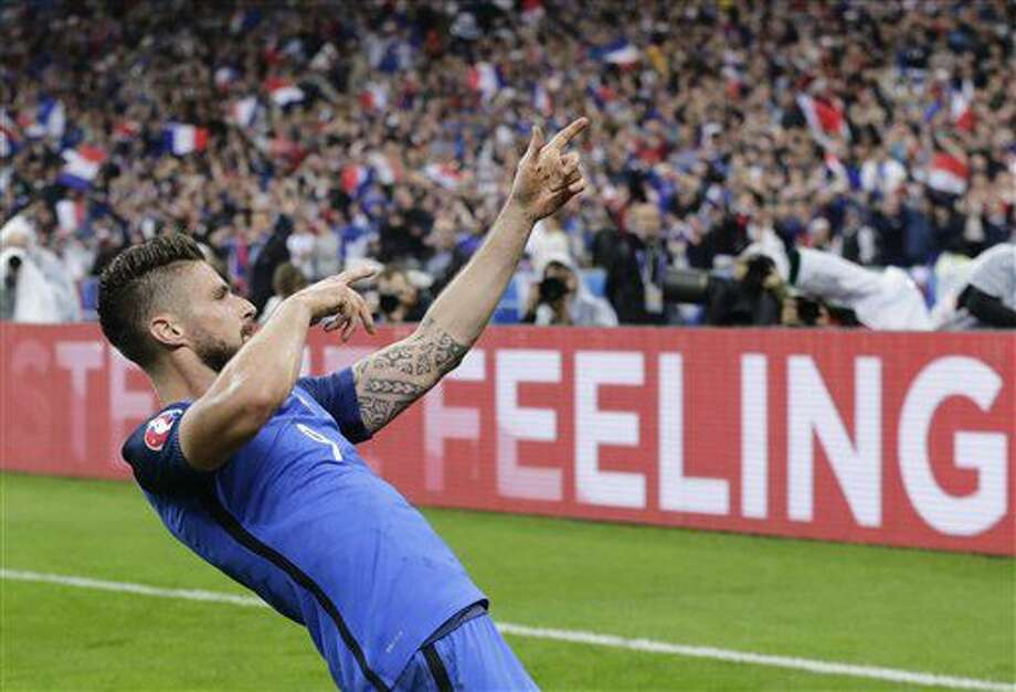 France's Olivier Giroud celebrates after scoring his side's fifth goal during the Euro 2016 quarterfinal soccer match between France and Iceland, at the Stade de France in Saint-Denis, north of Paris, France, Sunday, July 3, 2016. (AP Photo/Petr David Josek) Photo: Petr David Josek
