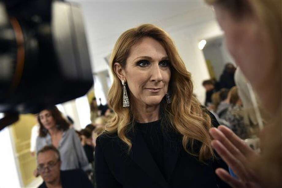 Canadian singer Celine Dion answers reporters before Christian Dior's Haute Couture Fall-Winter 2016-2017 fashion collection presented Monday, July 4, 2016 in Paris. (AP Photo/Zacharie Scheurer) Photo: Zacharie Scheurer