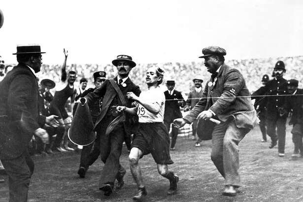Marathon: Italian runner Dorando Pietri finishing the marathon first with the help of others and is subsequently disqualified in the 1908 London Summer Olympic Games.