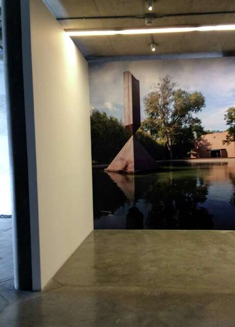 """On a back wall of the exhibit, a photo mural offers a """"view"""" of Rothko Chapel's reflection pool and Barnett Newman's """"Broken Obelisk."""" Photo: Ashley Clemmer Hoffman"""
