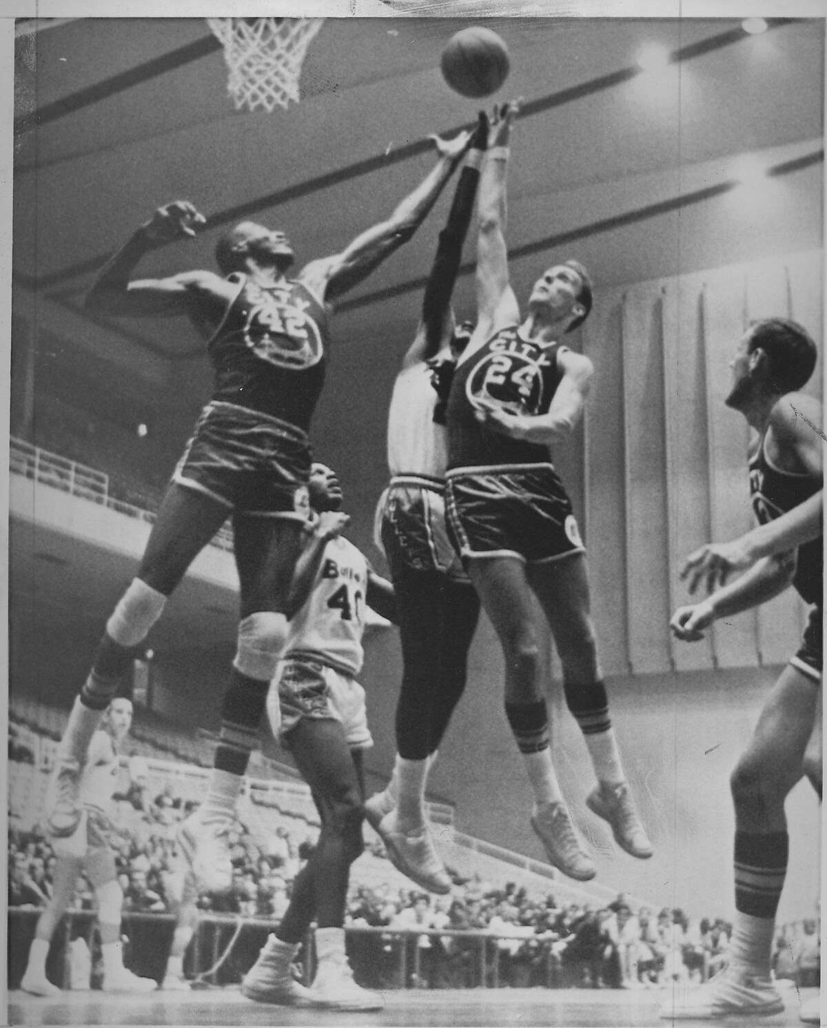 FILE-- Warriors players Nate Thurmond and Rick Barry battle for a rebound against the Baltimore Bullets, in Baltimore, MD Both Rick Barry and Nate Thurmond would be selected to start in the NBA All-Star Game that season. Photo taken Oct. 28, 1966.