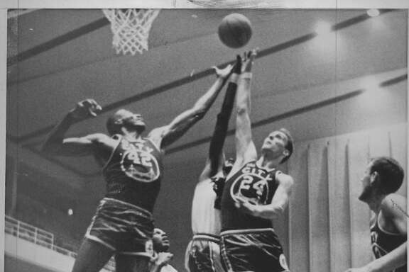 Warriors players Nate Thurmond and Rick Barry battle for a rebound against the Baltimore Bullets, in Baltimore, MD  Both Rick Barry and Nate Thurmond would be selected to start in the NBA All-Star Game that season AP Photo, Photo shot 10/28/1966 Photo ran 10/29/1966