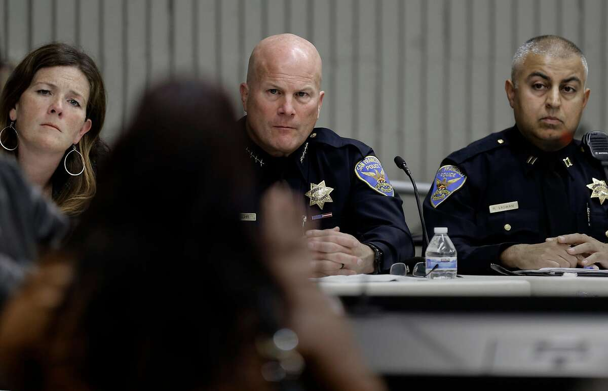 Suzy Loftus, president of the police commission, San Francisco Police Chief Greg Suhr and Bayview Station captain Raj Vaswani listen to comments from the crowd, listens to comments from the neighborhood as the San Francisco Police department hosts a town hall meeting, on Fri. December 4, 2015 to discuss the officer-involved shooting of 26-year-old Mario Woods in the Bayview neighborhood that sparked outrage nationwide after a video taken of the shooting was circulated on social media, in San Francisco, Calif.