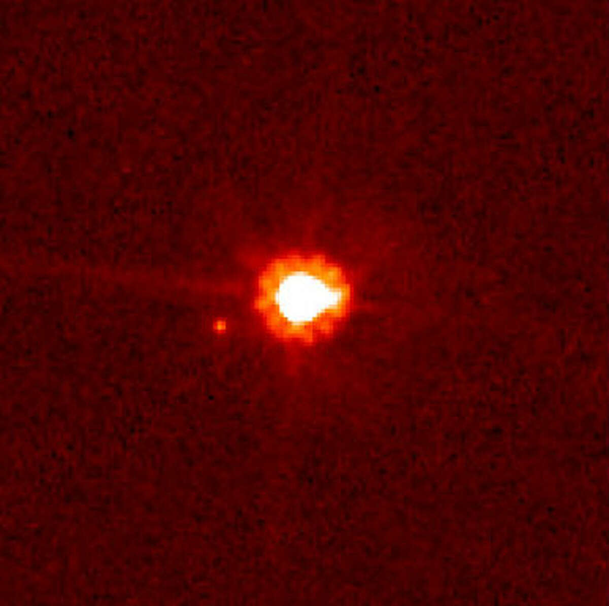 Eris (center) and Dysnomia (left of center), taken by the Hubble Space Telescope. Eric is the largest dwarf planet discovered so far at 2,330 km in diameter.