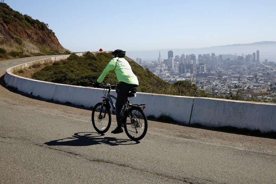 Jeffrey Perrone rides his bicycle in the new dedicated pedestrian and bike roadway at Twin Peaks in San Francisco, California, on Wednesday, July 13, 2016. Photo: Connor Radnovich, The Chronicle