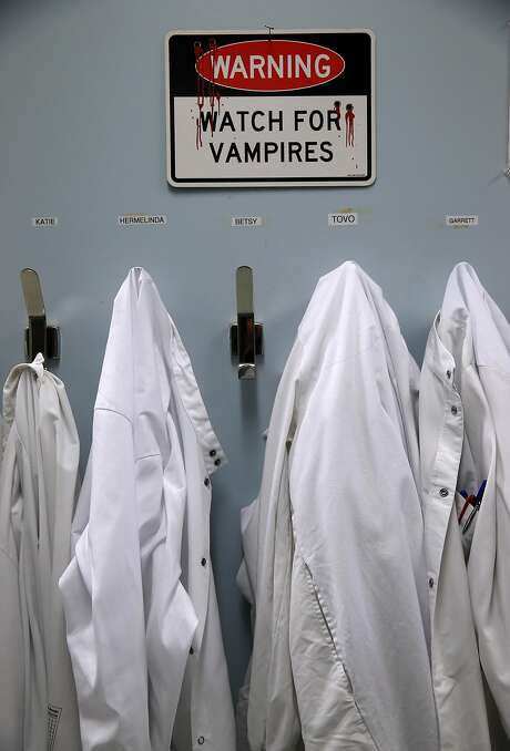 Lab coats hang in the Cerus lab where the Intercept blood system is developed and tested in Concord, Calif. on Wednesday, July 13, 2016. The Intercept system will be utilized in Brazil during the Olympic Games to minimize transmission of the Zika virus. Photo: Paul Chinn, The Chronicle