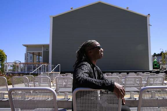 Designer, Walter Hood poses for a portrait in the seating area of the open air theater at the Bayview Opera House in San Francisco, California, on Wed. July 13, 2016. The city-owned landmark arts center which was built in 1888, received a three-year $5 million makeover and will reopen with ribbon cutting July 20.
