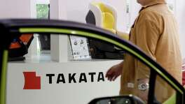 Takata executives are scheduled to meet in Japan with officials from more than a dozen customers this week, according to people with knowledge of the situation. The talks are prompted by five bids made for the beleaguered Takata. The central issue for Takata's customers, which include General Motors and Toyota, is how those takeover bids divvy up responsibility for paying billions of dollars in recall costs and potential legal liabilities stemming from faulty air bags.