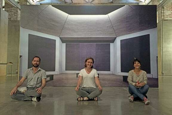 "Museo de Arte Moderno Medellin curator Emiliano Valdez, from left, Rothko Chapel director of community engaagement Ashley Clemmer Hoffman and visiting curator Maria Iovino in the Rothko Chapel installation that is part of the exhibition ""Concerning the Spiritual in Art. Overture,"" on view in Medellin, Colombia July 14-Sept. 11."