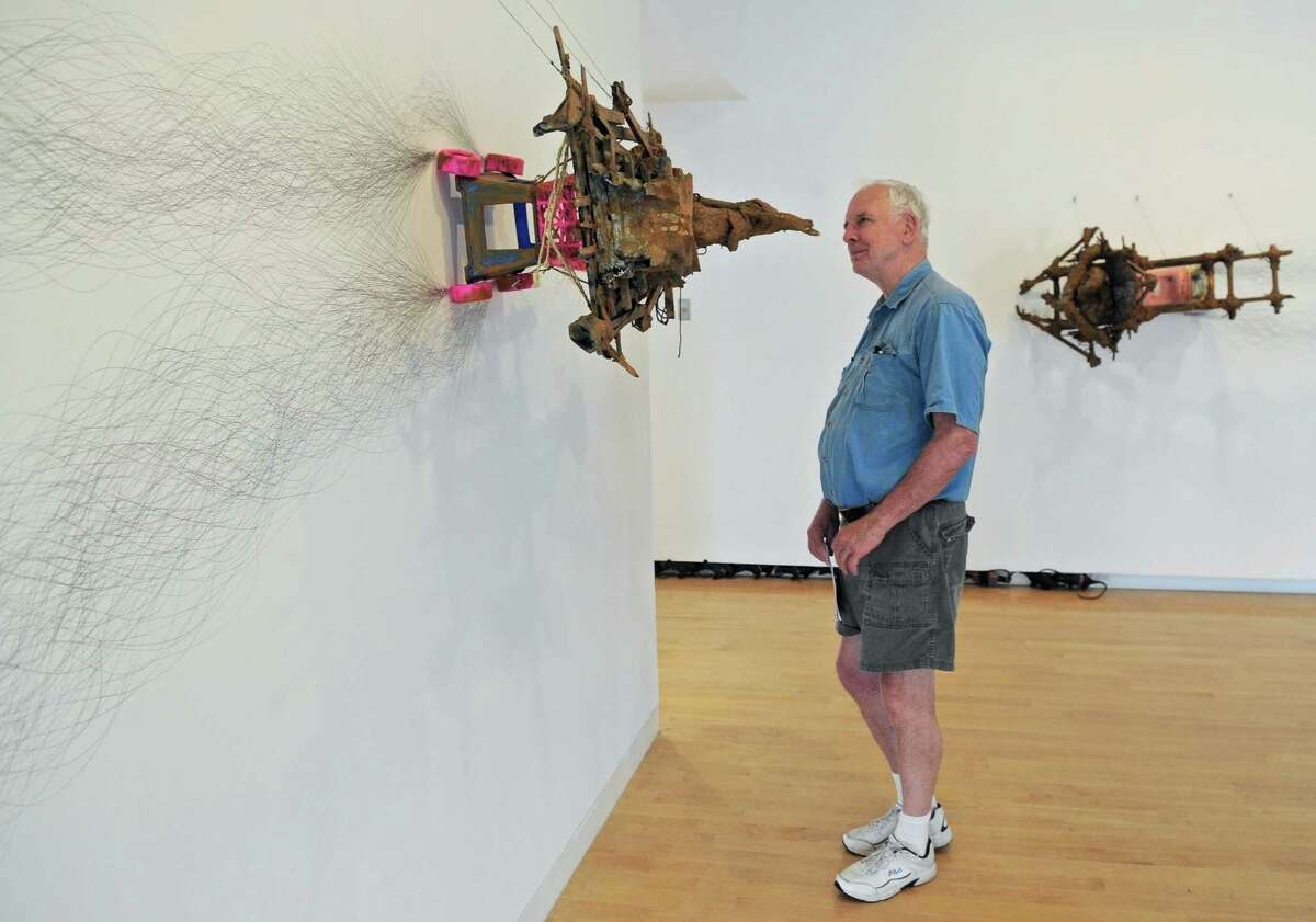 """Edwin Clark, of Washington D.C. looks at the work """"White Crow"""" by Kim Jones at the Aldrich Museum. The museum could be affected by the Connecticut State budget cuts that will impact tourism marketing spending in the western part of the state. Wednesday, July 13, 2016, in Ridgefield, Conn."""