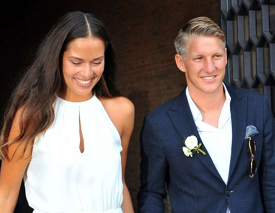 Tennis player Ana Ivanovic and Germany soccer player Bastian Schweinsteiger smile during their wedding, in Venice, Italy, Tuesday, July 12, 2016. (AP Photo/Luigi Costantini) Photo: Luigi Costantini, Associated Press