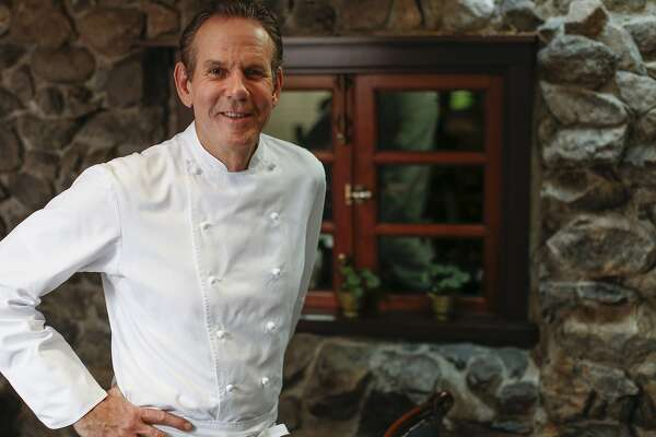 Chef Thomas Keller stands in front of the original exterior wall of The French Laundry on Wednesday, April 16, 2014 in Yountville, Calif.  The wall is now an interior wall of the alcove in the dining room.
