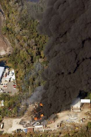 A column of smoke rises from the site of T2 Laboratories, Inc, Wednesday, Dec. 19, 2007 in Jacksonville, Fla. T2 Laboratories, Inc. manufacturers chemical solvents and fuel additives. (AP Photo/The Florida Times-Union, Bob Self)**TV OUT, MAGS OUT** Photo: Bob Self, AP / Copyright 2007, The Florida Tiimes-Union