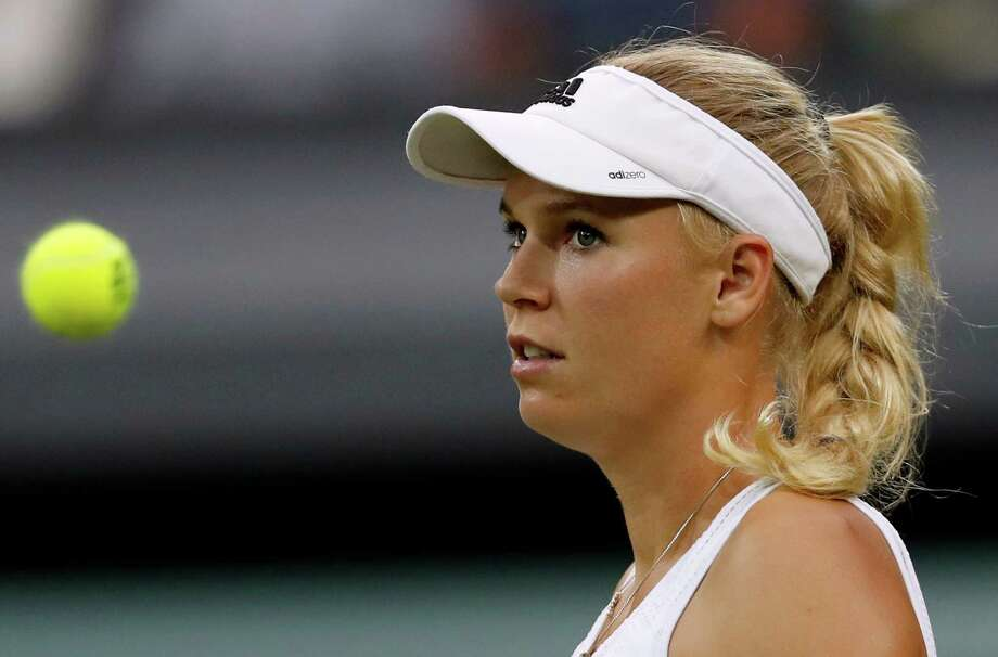 Four-time Connecticut Open champion Caroline Wozniacki has been given a wild card into this year's tournament. Photo: Ben Curtis / Associated Press / Copyright 2016 The Associated Press. All rights reserved. This material may not be published, broadcast, rewritten or redistribu