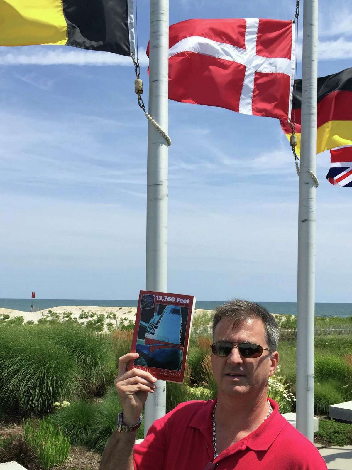 """The title of Greenwich native Mark Berry's memoir """"13,760 Feet,"""" refers to the altitude of TWA Flight 800 which exploded off Long Island 19 years. Berry's fiance was on that flight."""