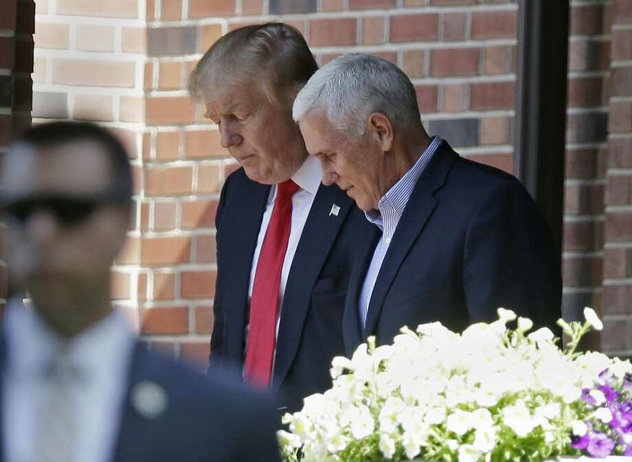 Republican presidential candidate Donald Trump leaves the Indiana Governor's residence with Gov. Mike Pence in Indianapolis, Wednesday, July 13, 2016. Photo: Michael Conroy, Associated Press