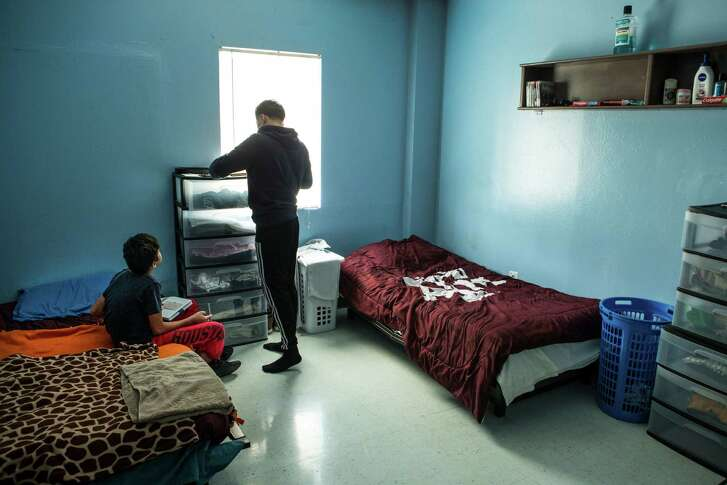 A pair of residents of the Tejano Center for Community Concerns Emergency Shelter hang out in their room at the facility on Tuesday, July 12, 2016, in Houston. The emergency shelter stands at the site that city council is considering allocating $3.5 million in federal grants to help build an affordable housing complex geared toward youth aging out of foster care.