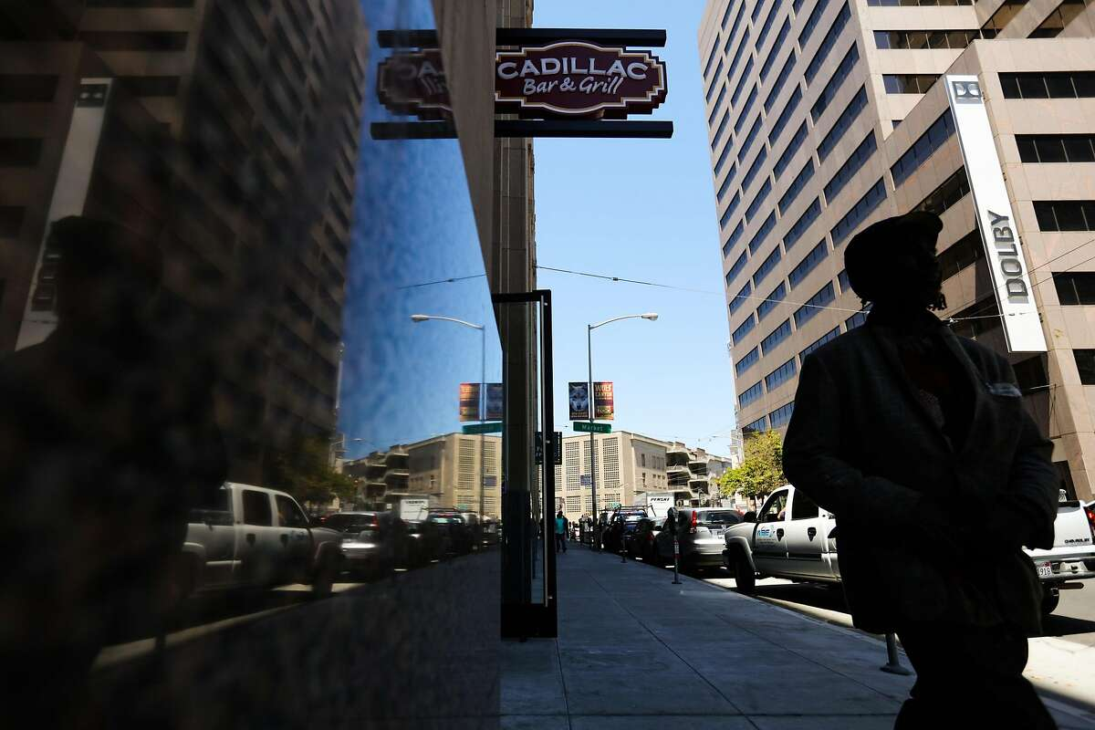 A man walks on 9th Street past restaurant Cadillac Bar & Grill in San Francisco, California, on Wednesday, July 13, 2016.