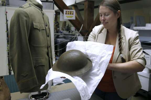 Amanda Williford, curator of the GGNRA Park Archives and Records Center, prepares a World War I soldiers uniform display in San Francisco, Calif. on Tuesday, July 12, 2016. The museum will hold an open house to the public this coming Sunday and Monday.