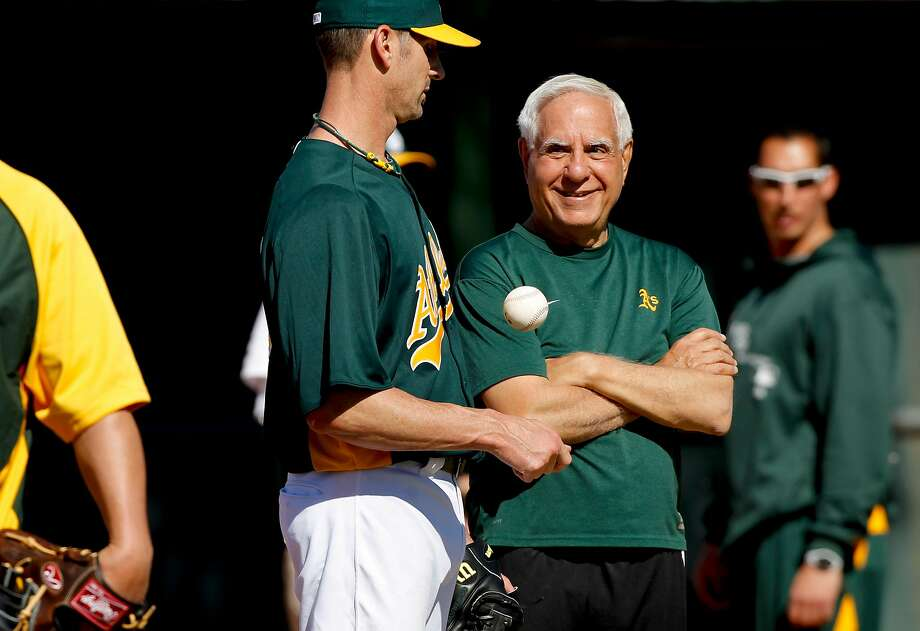 "A's owner Lew Wolff (center), with then-A's pitcher Grant Balfour, says he and fellow owner John Fisher are ""not sellers"" and are constantly working toward a solution involving a place to play in the city of Oakland. Photo: Michael Macor, The Chronicle"