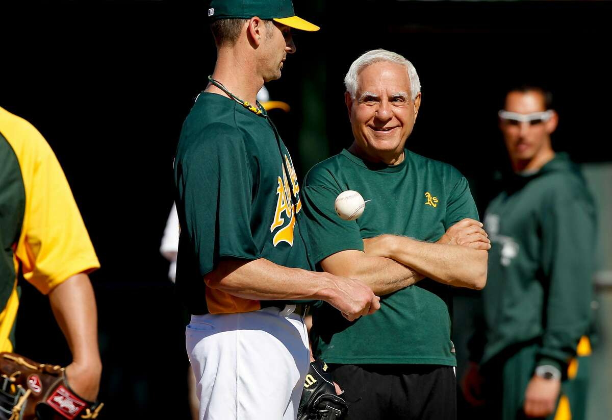 Oakland A's pitcher Grant Balfour talk with former A's owner Lew Wolff, during morning workouts at Phoenix Municipal Stadium on Tuesday Mar. 12, 2013, in Phoenix.