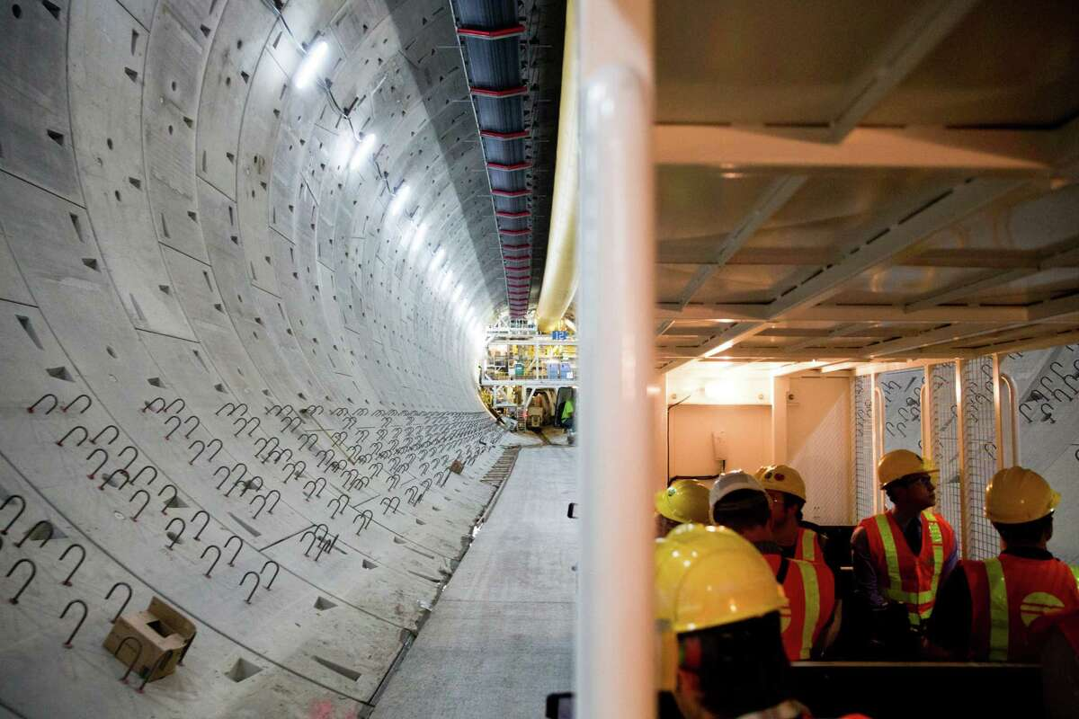 Journalists are shuttled through the state Route 99 viaduct tunnel to the end of Bertha, the tunneling machine, on Wednesday, July 13, 2016.