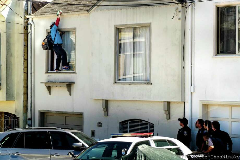 A man who threatened to commit suicide during a 22-hour standoff with police at one point walked onto his window's ledge, police said. Photo: San Francisco Police Department / San Francisco Police Department
