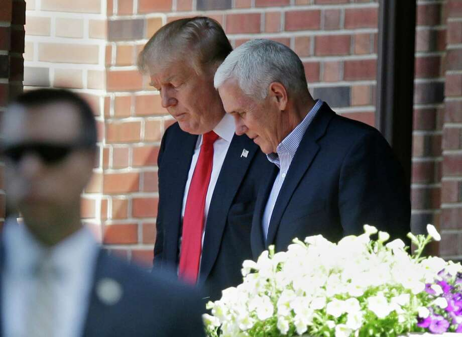 Indiana Gov. Mike Pence, a potential running mate of Republican presidential candidate Donald Trump, is seen with Trump at the governor's residence in Indianapolis. Photo: Michael Conroy / Associated Press / Copyright 2016 The Associated Press. All rights reserved. This material may not be published, broadcast, rewritten or redistribu