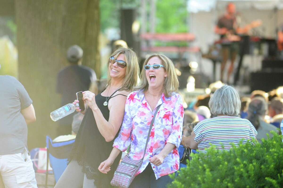 Stamford friends Cathy Hickey, right, and Kathy Totino dance during the opening act of Wednesday Nite Live at Columbus Park on Wednesday, July 13, 2016.