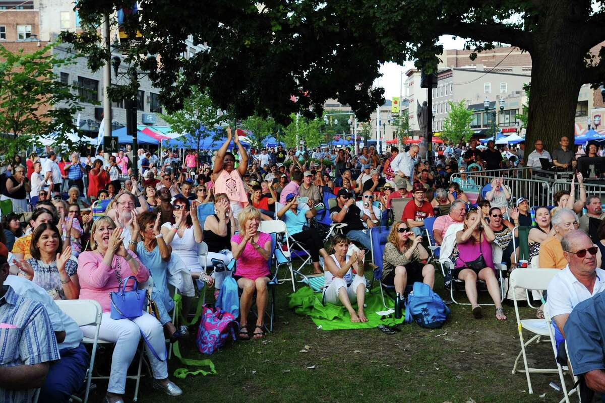 The crowd at Wednesday Nite Live applauds as headline act The 5th Dimension walk on stage at Columbus Park on Wednesday, July 13, 2016.