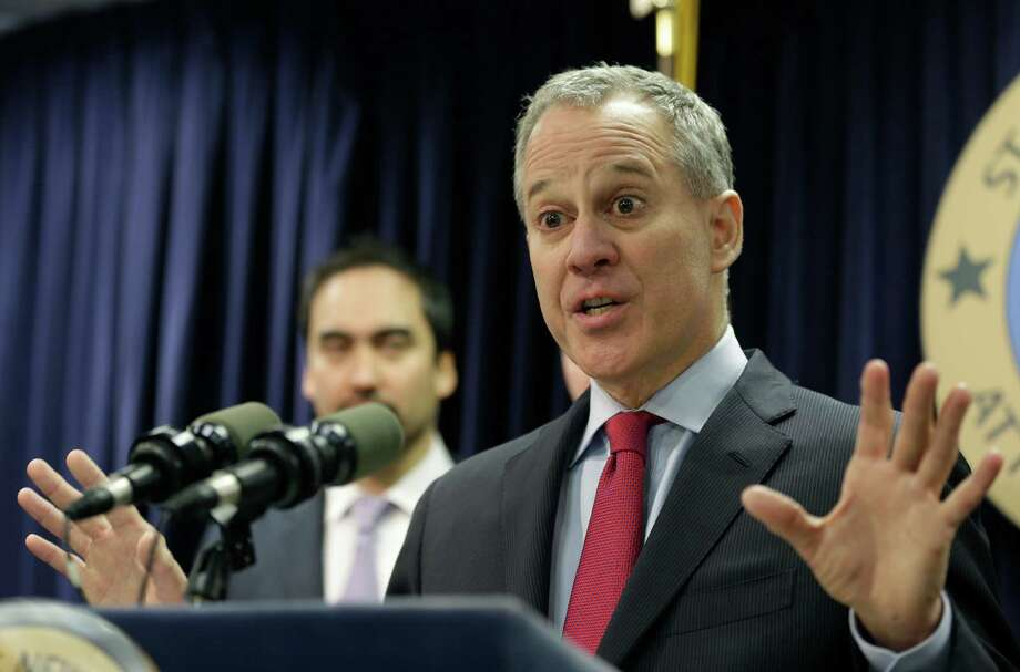 New York Attorney General Eric Schneiderman speaks at a new conference in New York, Monday, March 21, 2016. The nation's two largest daily fantasy sports websites have agreed to stop taking paid bets in New York through the end of baseball season, in September, as lawmakers consider legalizing the popular online contests, the state's attorney general announced Monday. (AP Photo/Seth Wenig) ORG XMIT: NYSW106 Photo: Seth Wenig / Copyright 2016 The Associated Press. All rights reserved. This m